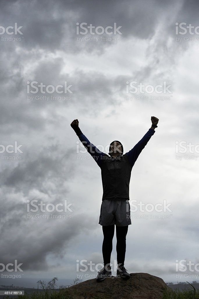 Triumph at the top stock photo
