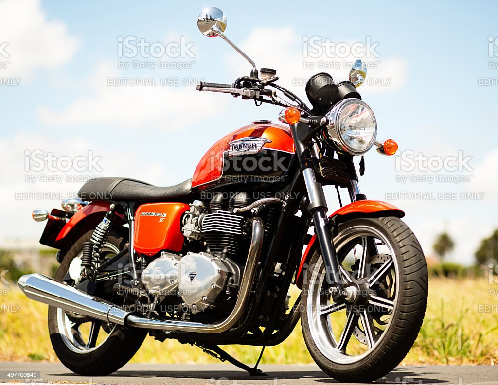 Triumph Bonneville 2012 model retro-styled motorbike on country road stock photo