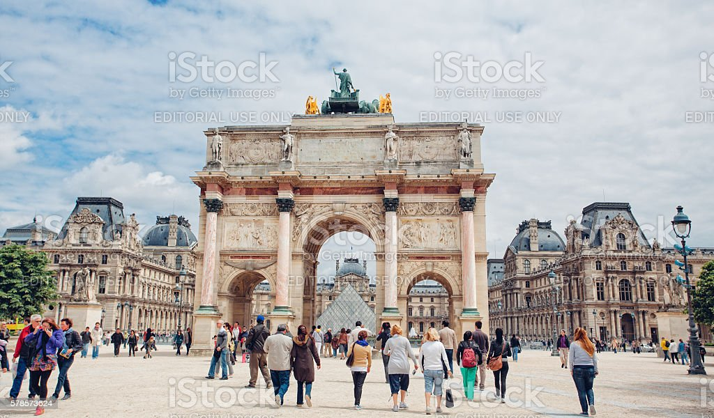 Triumphal Arch and Louvre Palace in Paris, France stock photo
