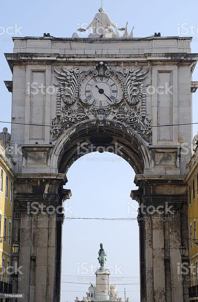 Triumphal Arch with ornamental clock (Lisbon, Portugal) stock photo
