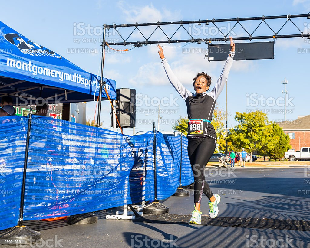 Triumphant 5k Run Leap stock photo