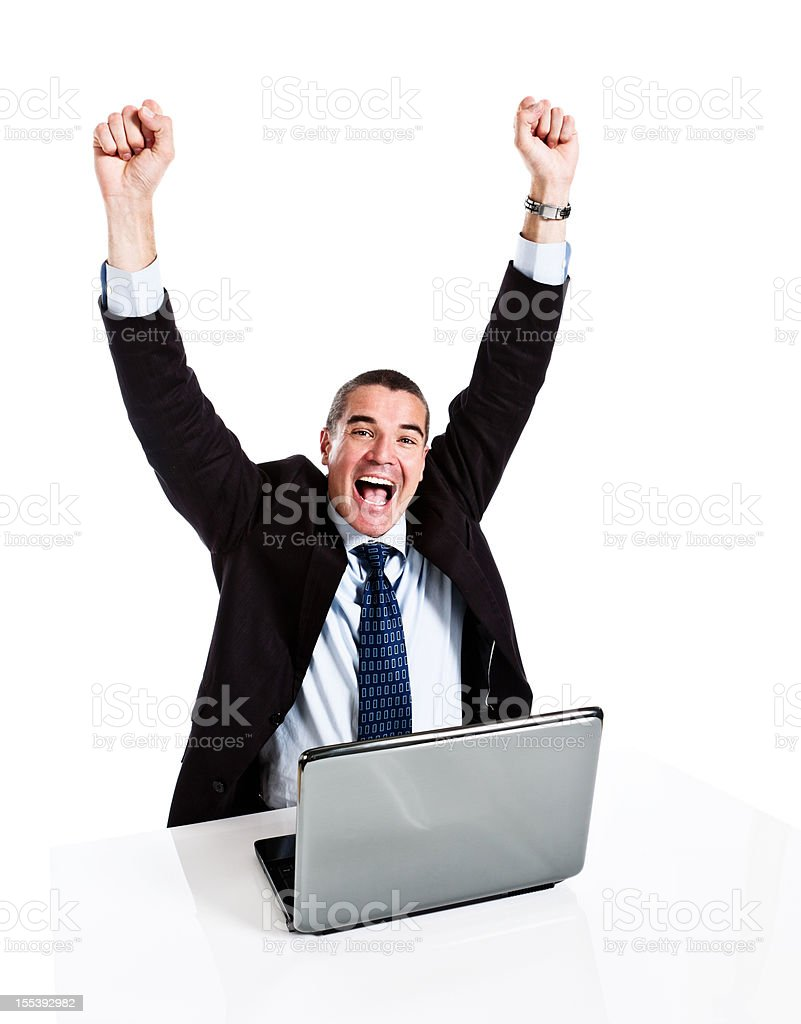 Triumphant businessman gestures in delight at laptop discovery royalty-free stock photo