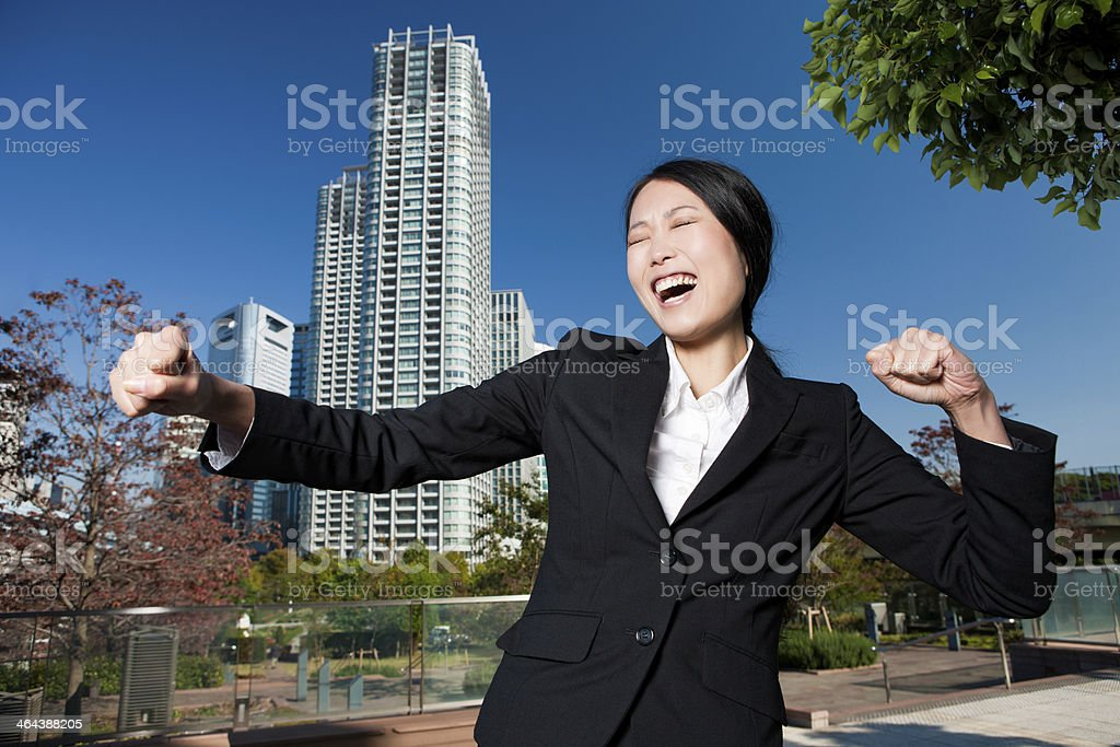 Triumphant Female in Business Attire royalty-free stock photo