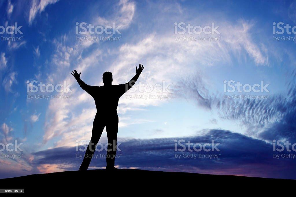 XXXL triumphant man silhouette stock photo
