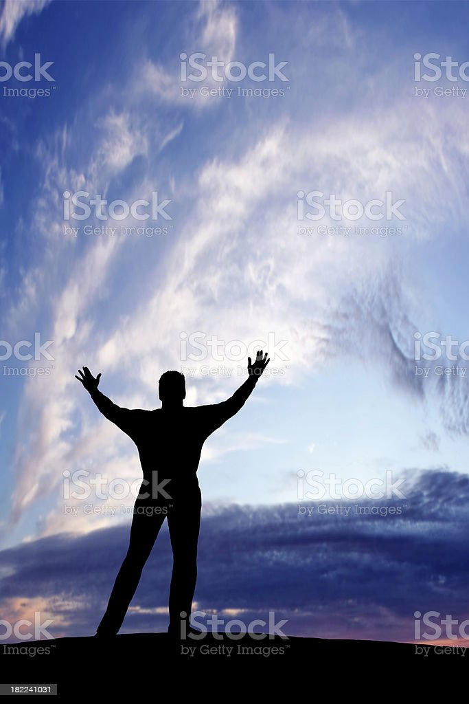 XXL triumphant man silhouette royalty-free stock photo
