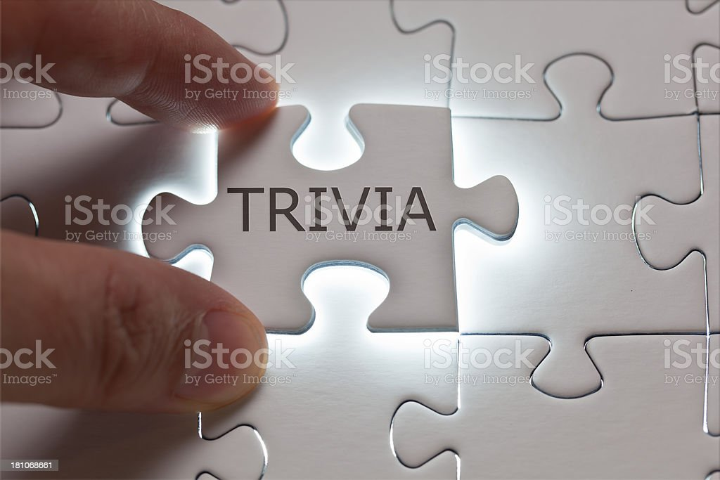 Trivia word written on a puzzle piece royalty-free stock photo