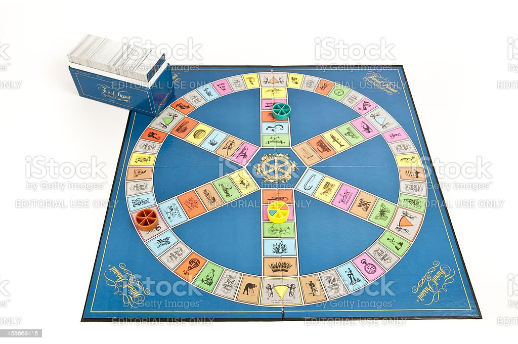 Trivial Pursuit Game Board with Card Box and  Player Pieces stock photo