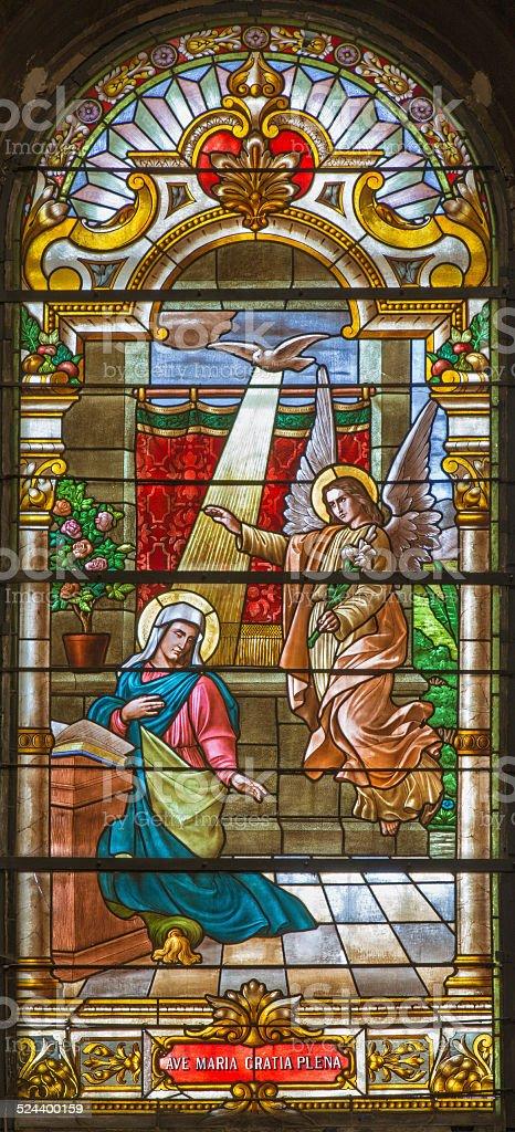 Trnava - annunciation in baroque windowpane from St. Nicholas church stock photo