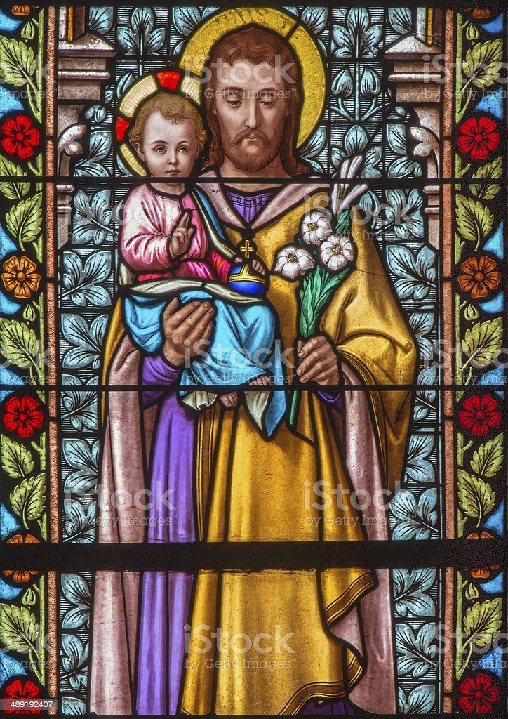Trnava - Saint Joseph from windowpane of st. Helen church stock photo