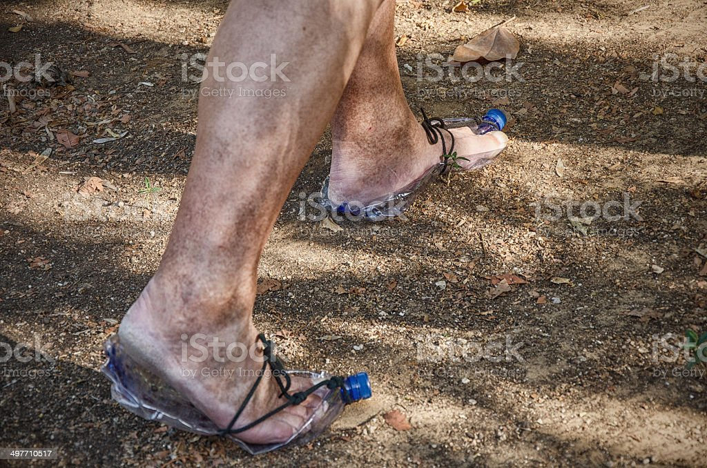 Troglodyte going in plastic bottle shoes royalty-free stock photo