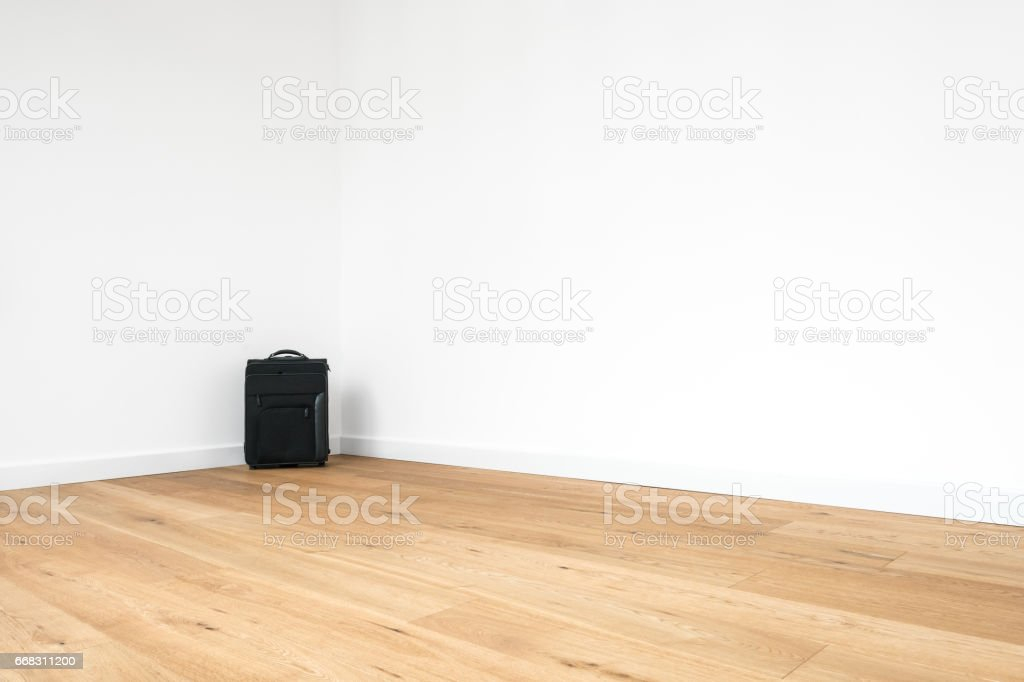 trolley, rolling suitcase in empty  room stock photo