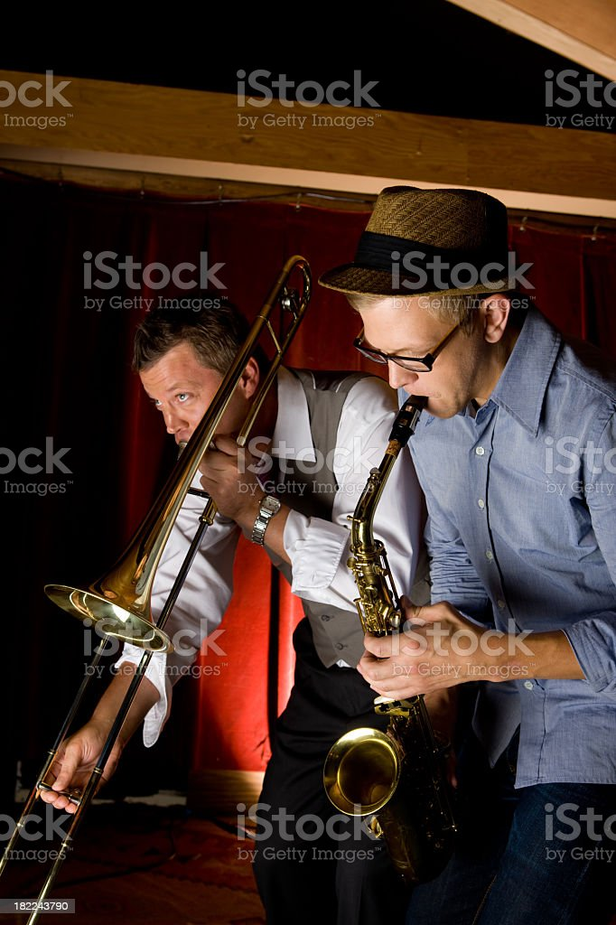 Trombone and Saxophone Player At Bar stock photo