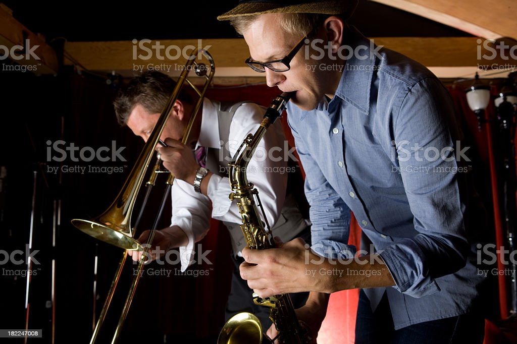 Trombone and Saxophone Player At Bar royalty-free stock photo