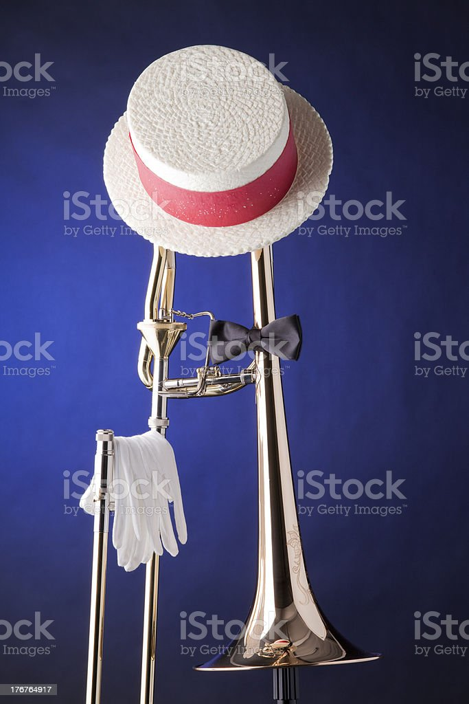Trombone Hat Bow Tie Isolated on Blue stock photo