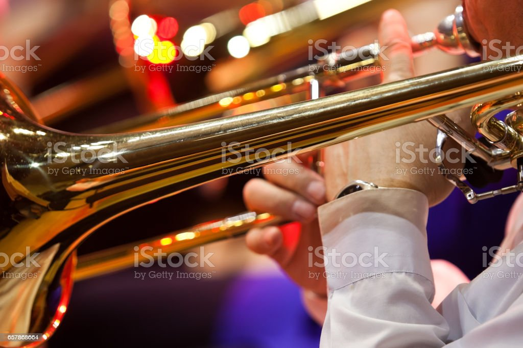 Trombone in the hands of a musician closeup stock photo