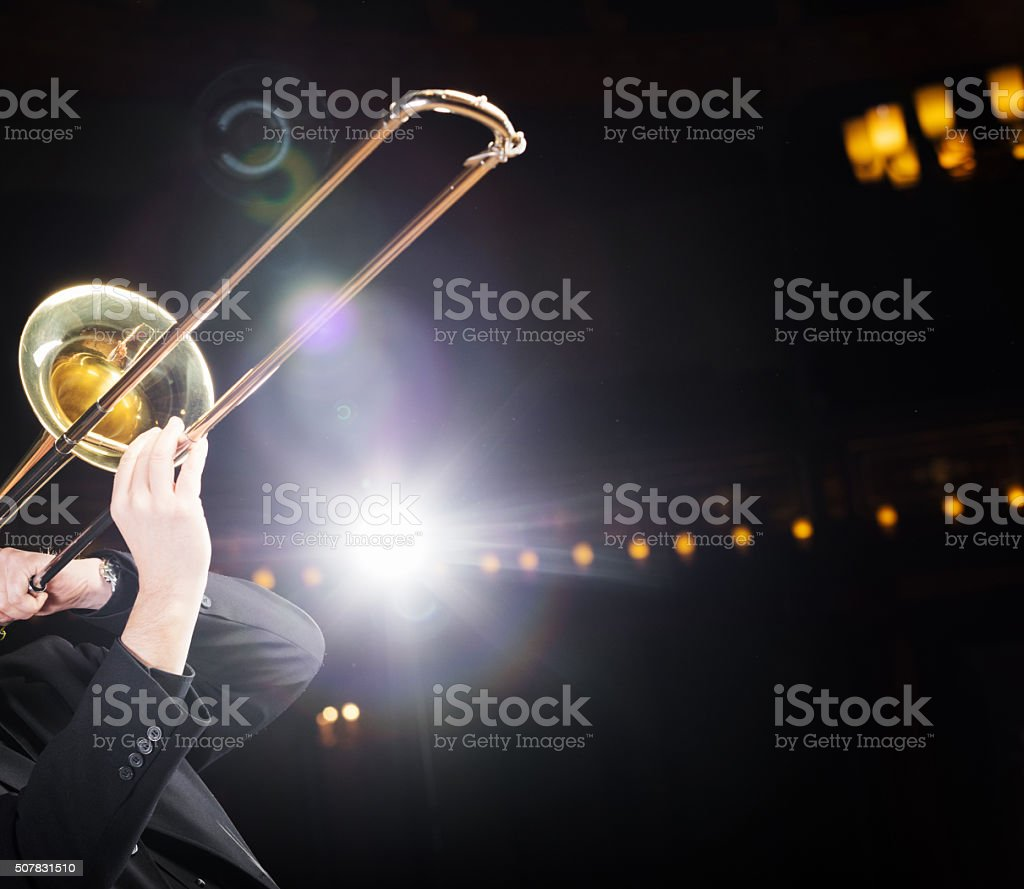 Trombone player with backlight stock photo