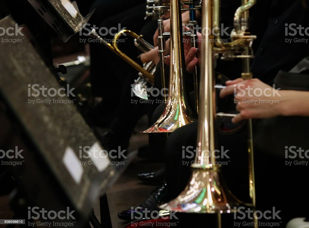 Trombone players in orchestra stock photo