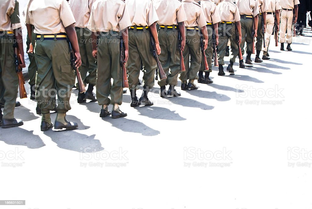 troops or soldiers marching in line stock photo