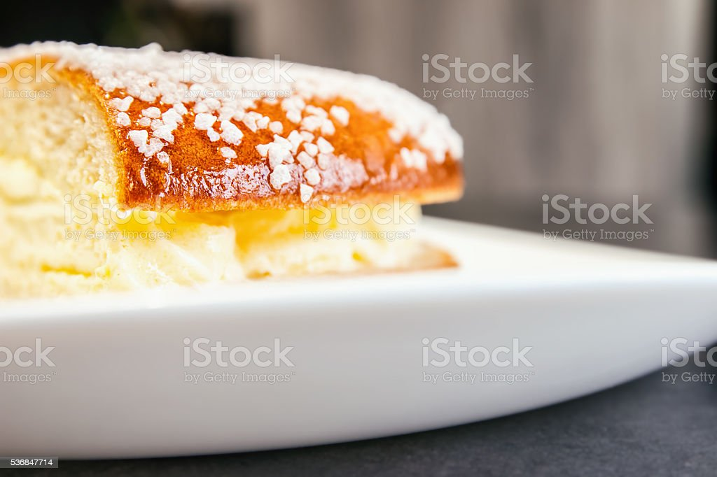 Tropezian Pie (Tropezienne) homemade french cake selective focus close-up stock photo