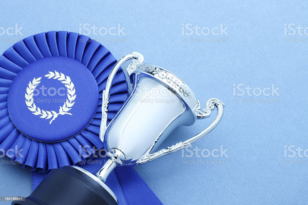 Trophy and Blue Ribbon royalty-free stock photo