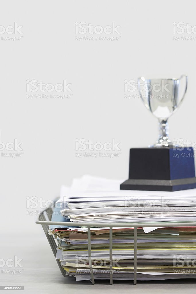 Trophy on Top of Papers royalty-free stock photo