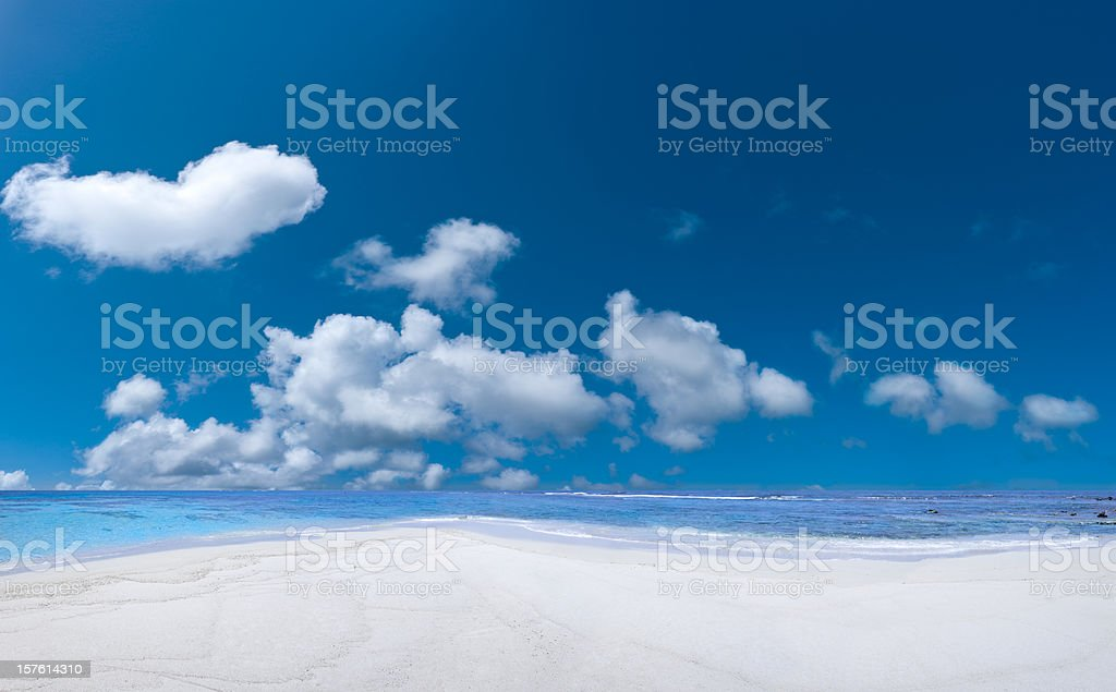Tropical Beach and cloudy deep blue sky royalty-free stock photo