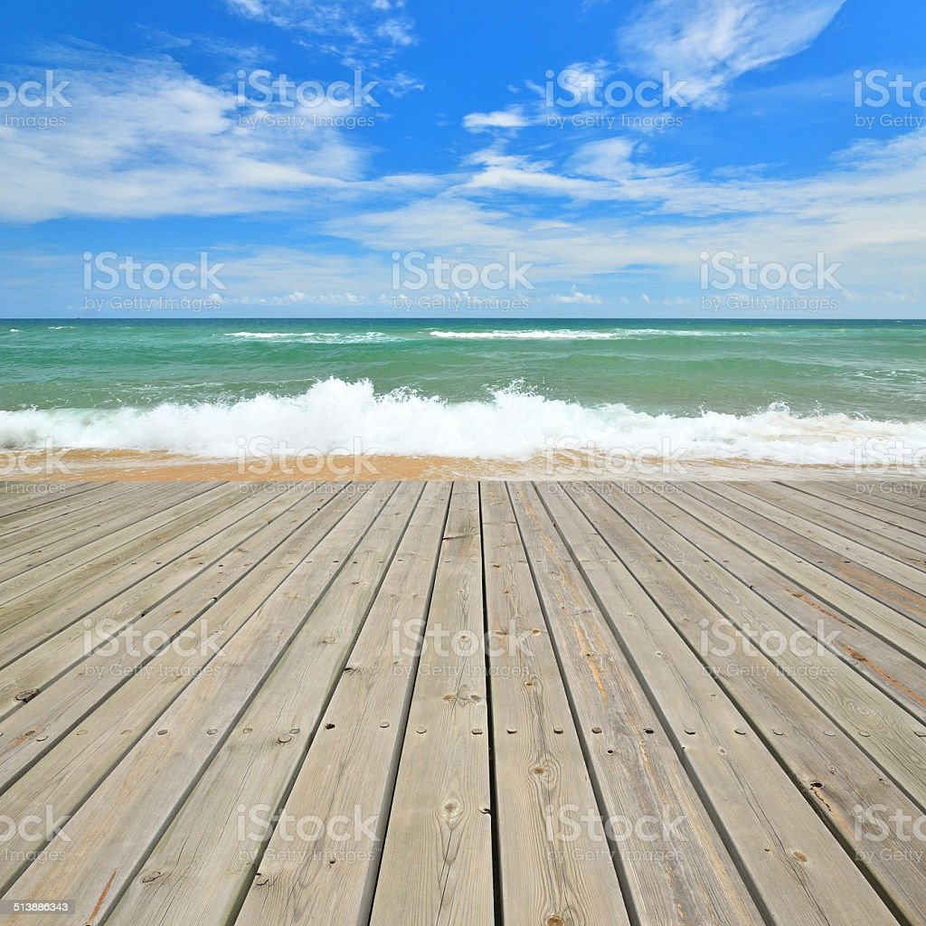 Tropical beach and empty wooden platform stock photo