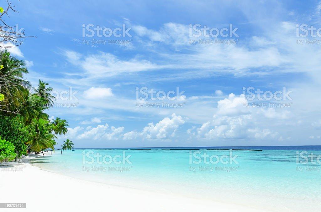 Tropical beach and green lagoon stock photo