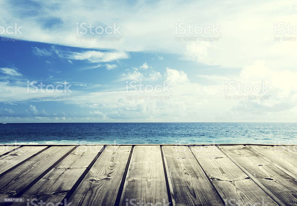 tropical beach and wooden platform stock photo