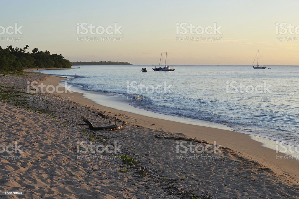 Tropical beach at sunset royalty-free stock photo