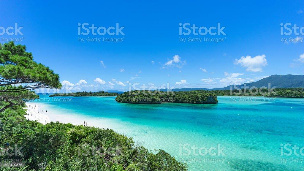 Tropical beach, clear blue lagoon and rock islands, Okinawa, Japan stock photo