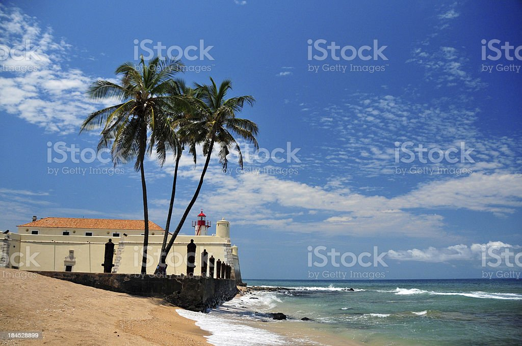 tropical beach, coconut trees and colonial fort stock photo