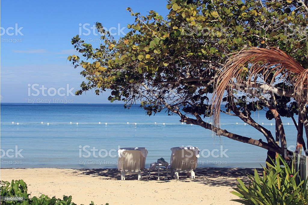 Tropical beach in Jamaica and blue Caribbean sea royalty-free stock photo