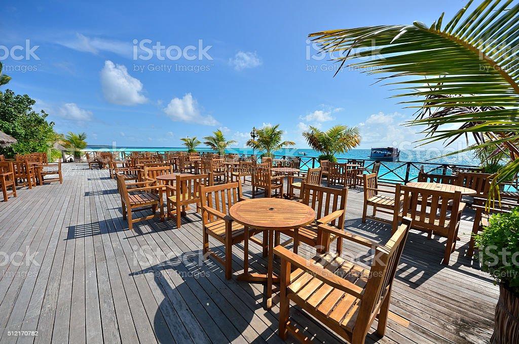 Tropical beach overwater restaurant stock photo