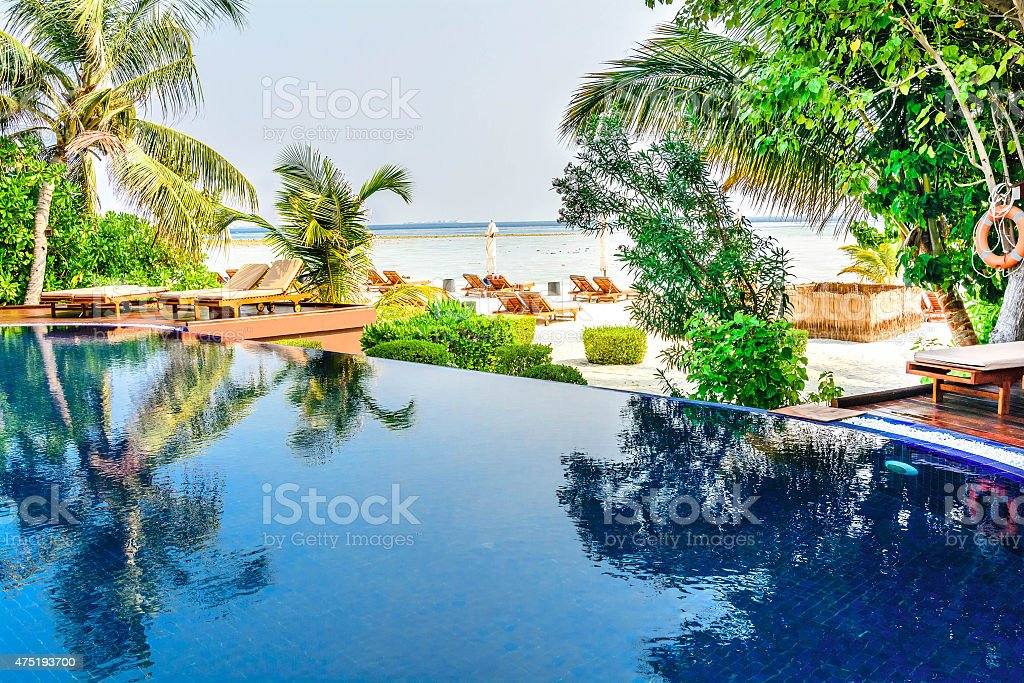 Tropical beach resort swimming pool in Maldives stock photo