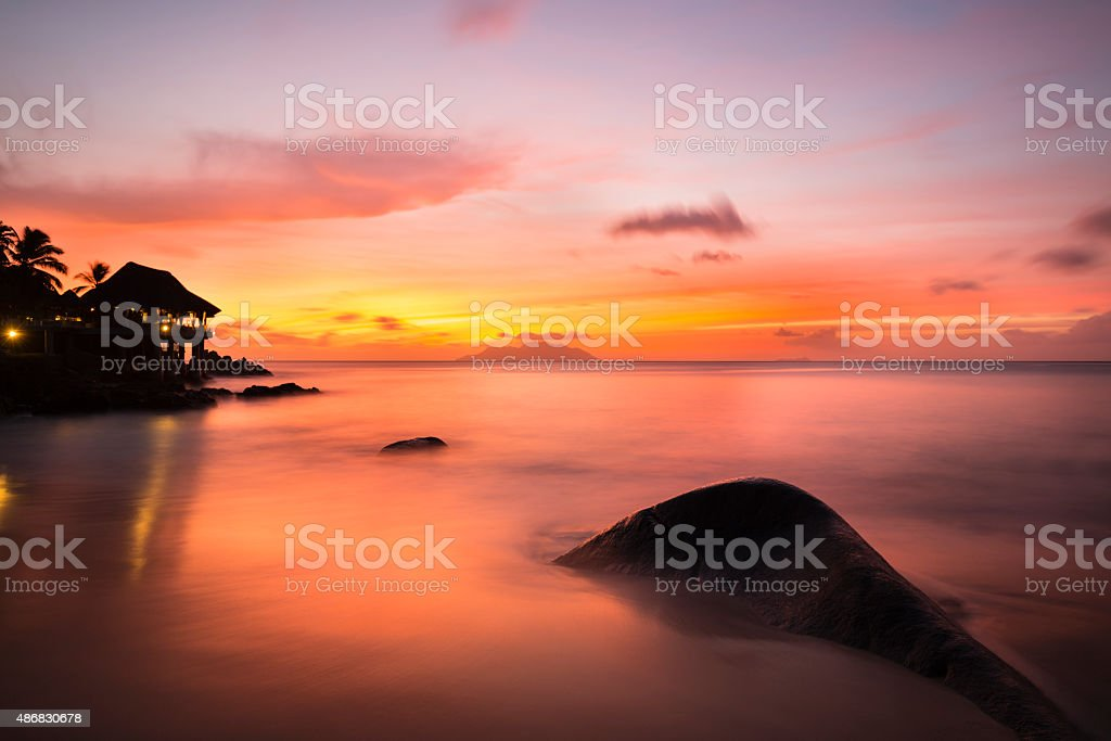 Tropical Beach Sunset in Mahe, Seychelles stock photo