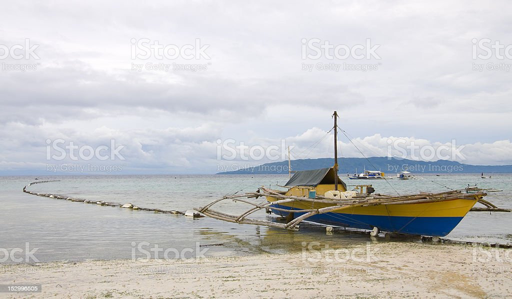 Tropical beach, traditional long tail boat, Bohol, Philippines stock photo