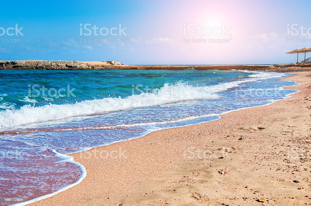 Tropical beach with blue sea stock photo
