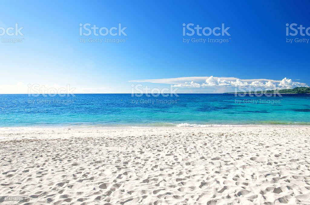Tropical beach with blue sky background stock photo