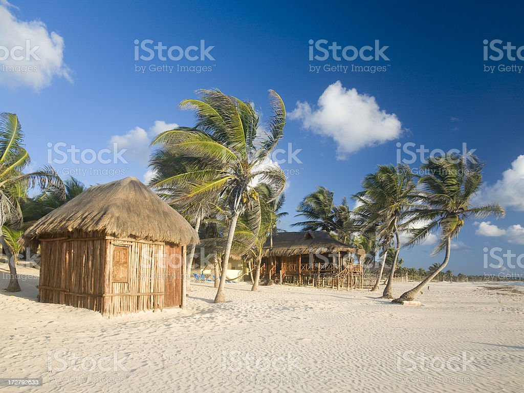 Tropical Beach with Cabanas royalty-free stock photo