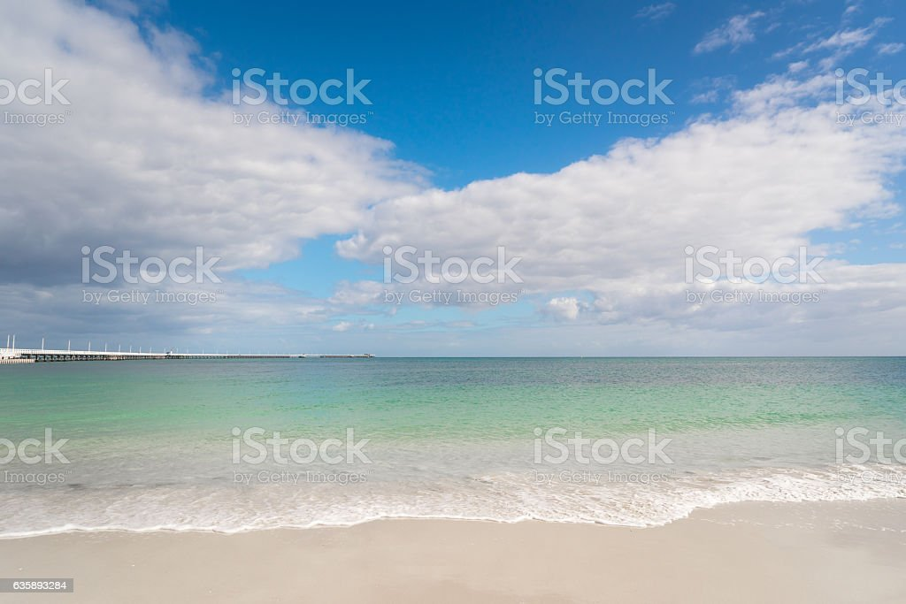 Tropical beach, with clear water in the background stock photo