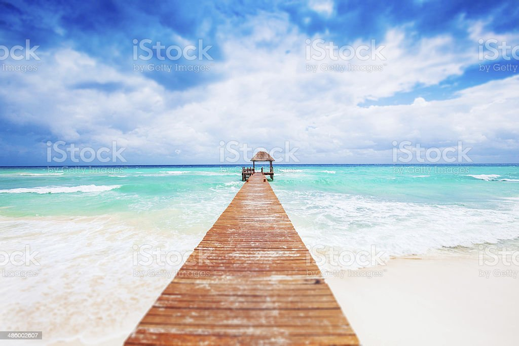 Tropical Beach with jetty. Mexico. Riviera Maya. stock photo