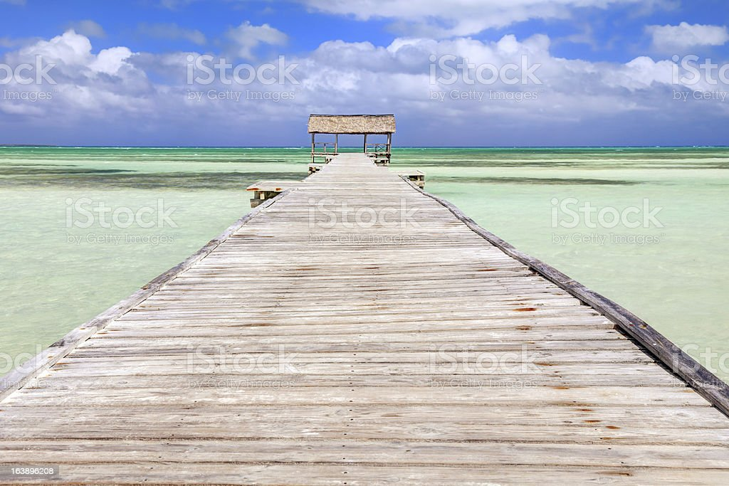 Tropical beach with pier stock photo
