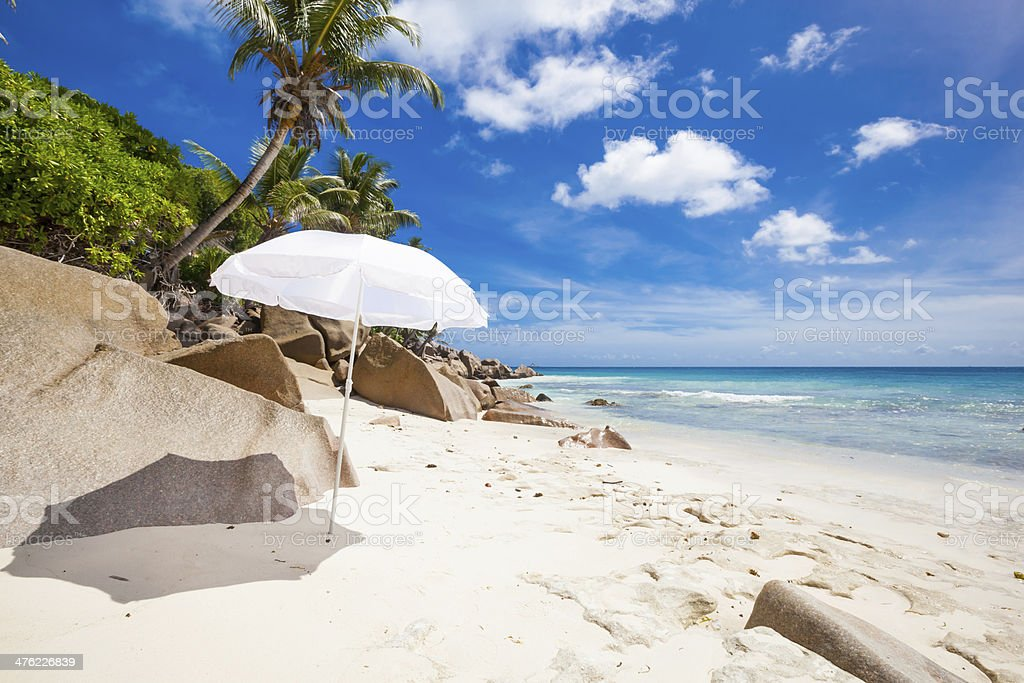 tropical beach with sunshade royalty-free stock photo