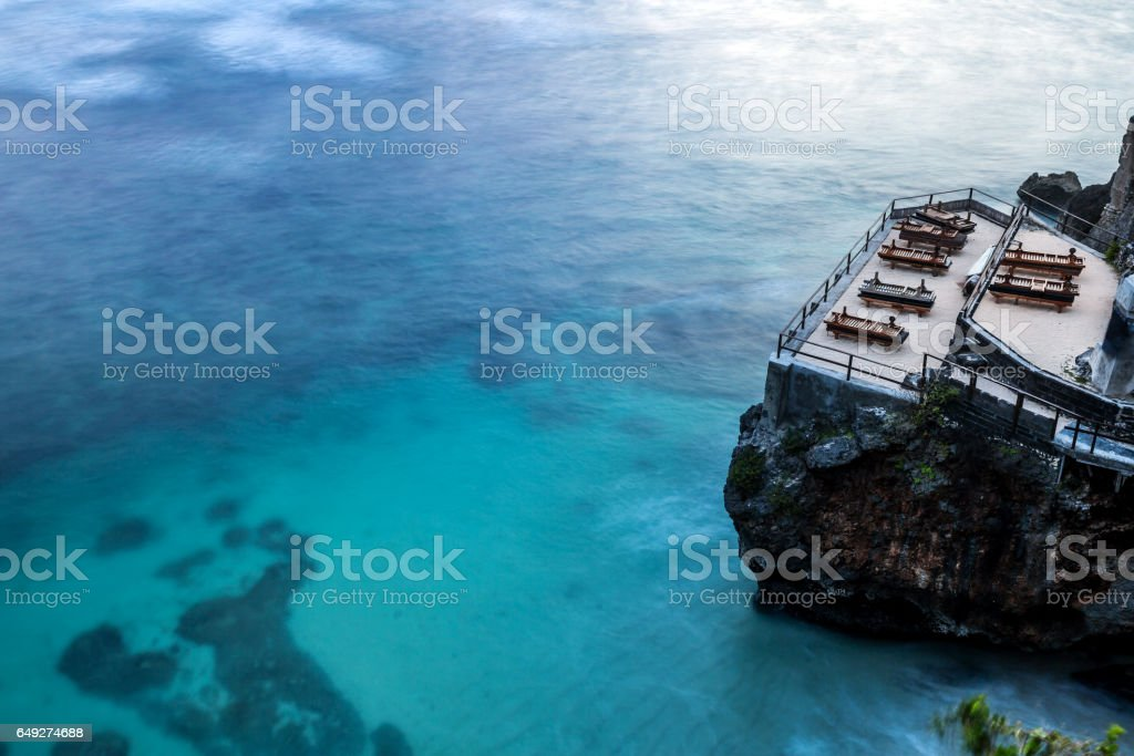 Tropical beach with wooden a sun lounger stock photo