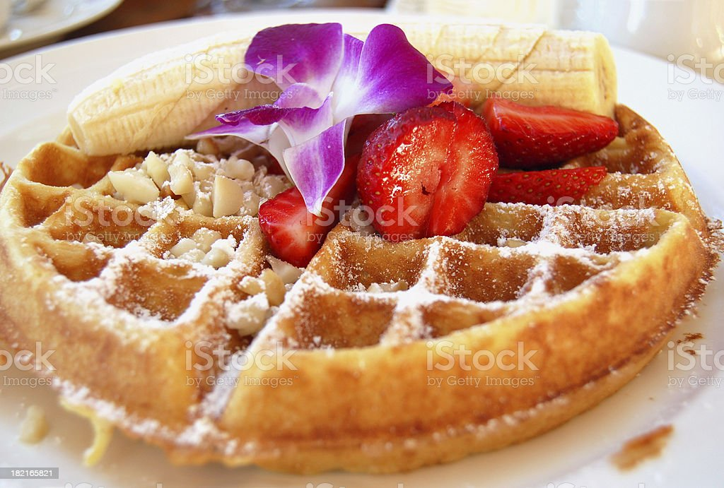 Tropical Belgian Waffle breakfast with Fruit and Macadamia Nuts stock photo