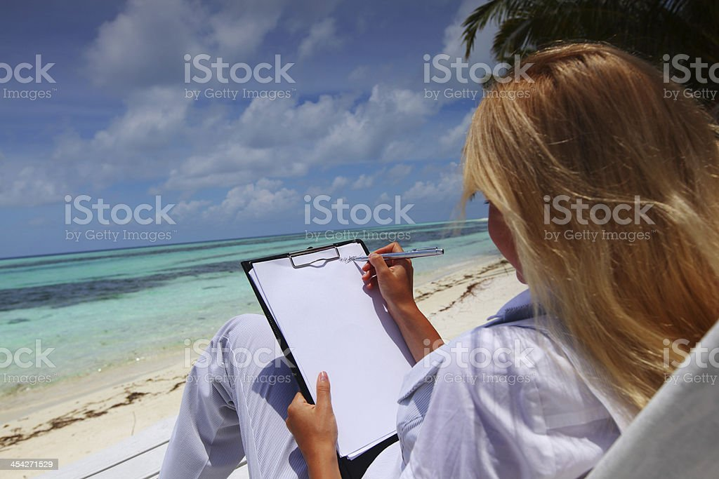 tropical business woman with blank paper royalty-free stock photo