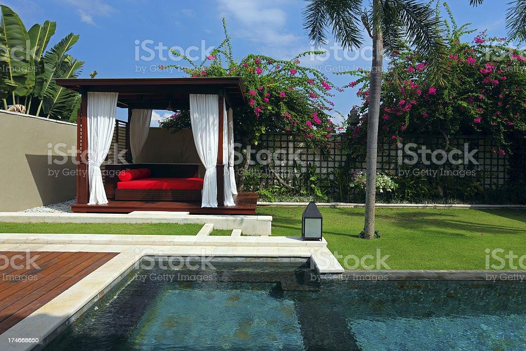 Tropical cabana (gazebo) and swimming pool (XXXL) stock photo