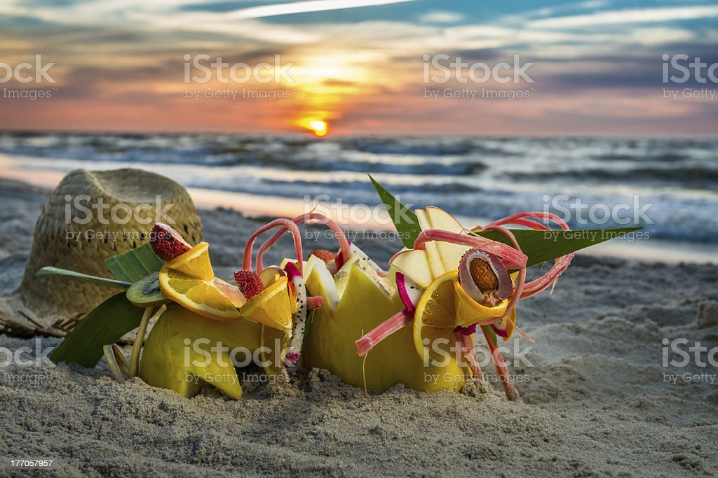 Tropical cocktail on the beach at sunset royalty-free stock photo