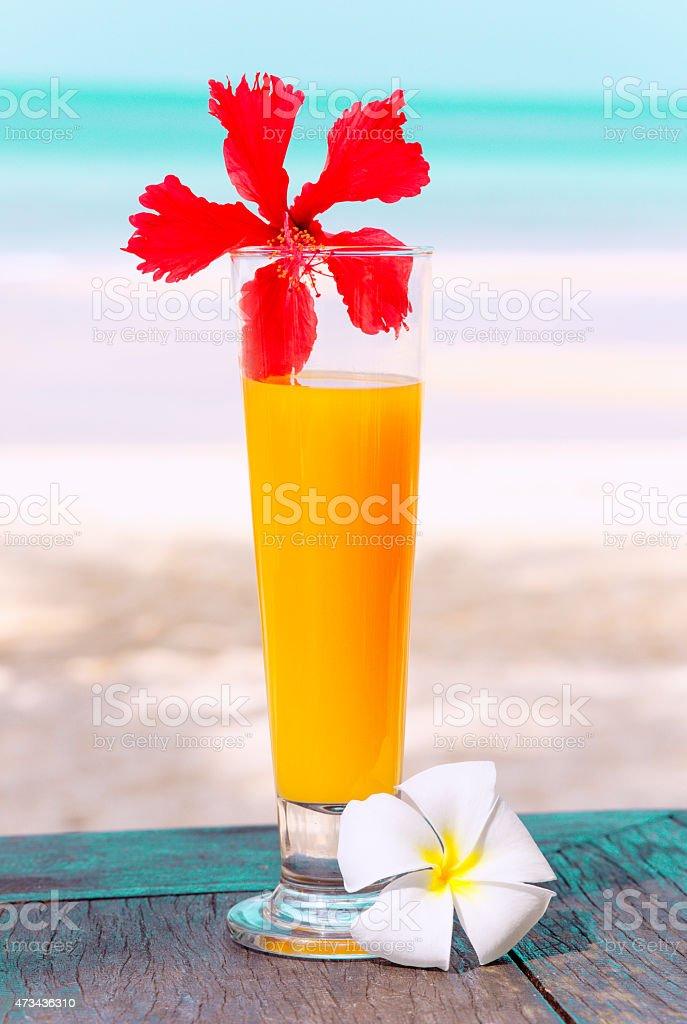 Tropical cocktail on the beach. Orange juice. stock photo